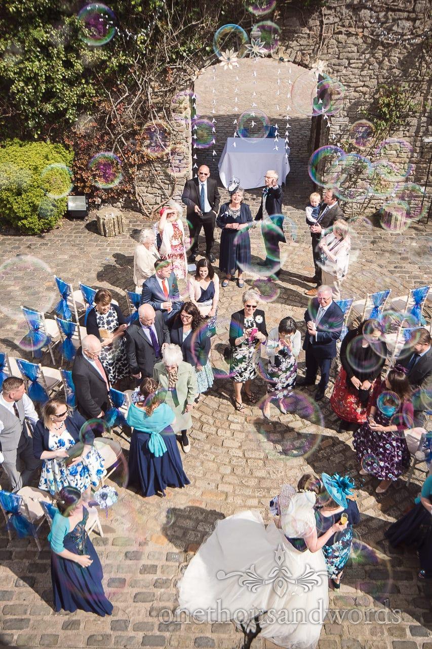 Wedding guests through bubbles at Walton Castle wedding photographs