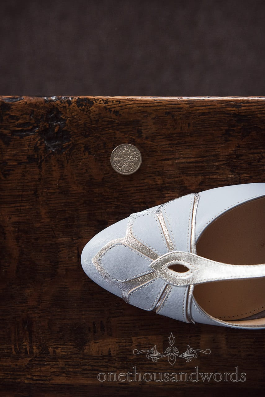 Wedding shoe and lucky sixpence at Walton Castle wedding photographs