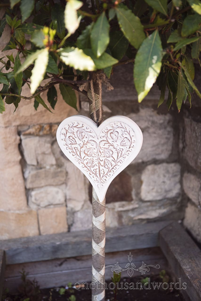 Wooden heart decoration at Scaplens court wedding photographs