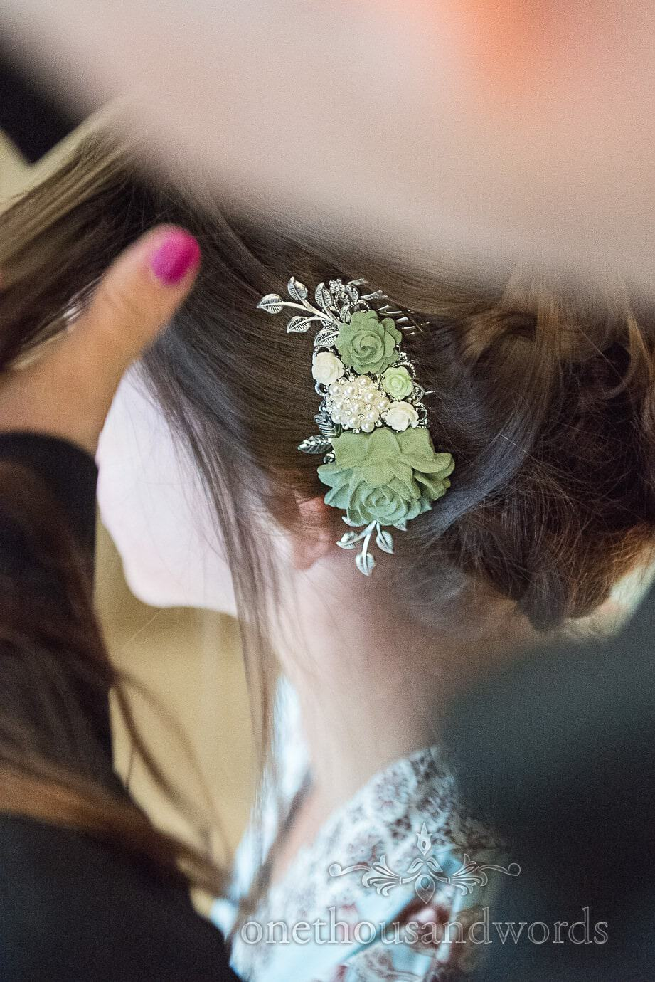 beautiful bridal green, white and silver floral hair grip added to wedding hair