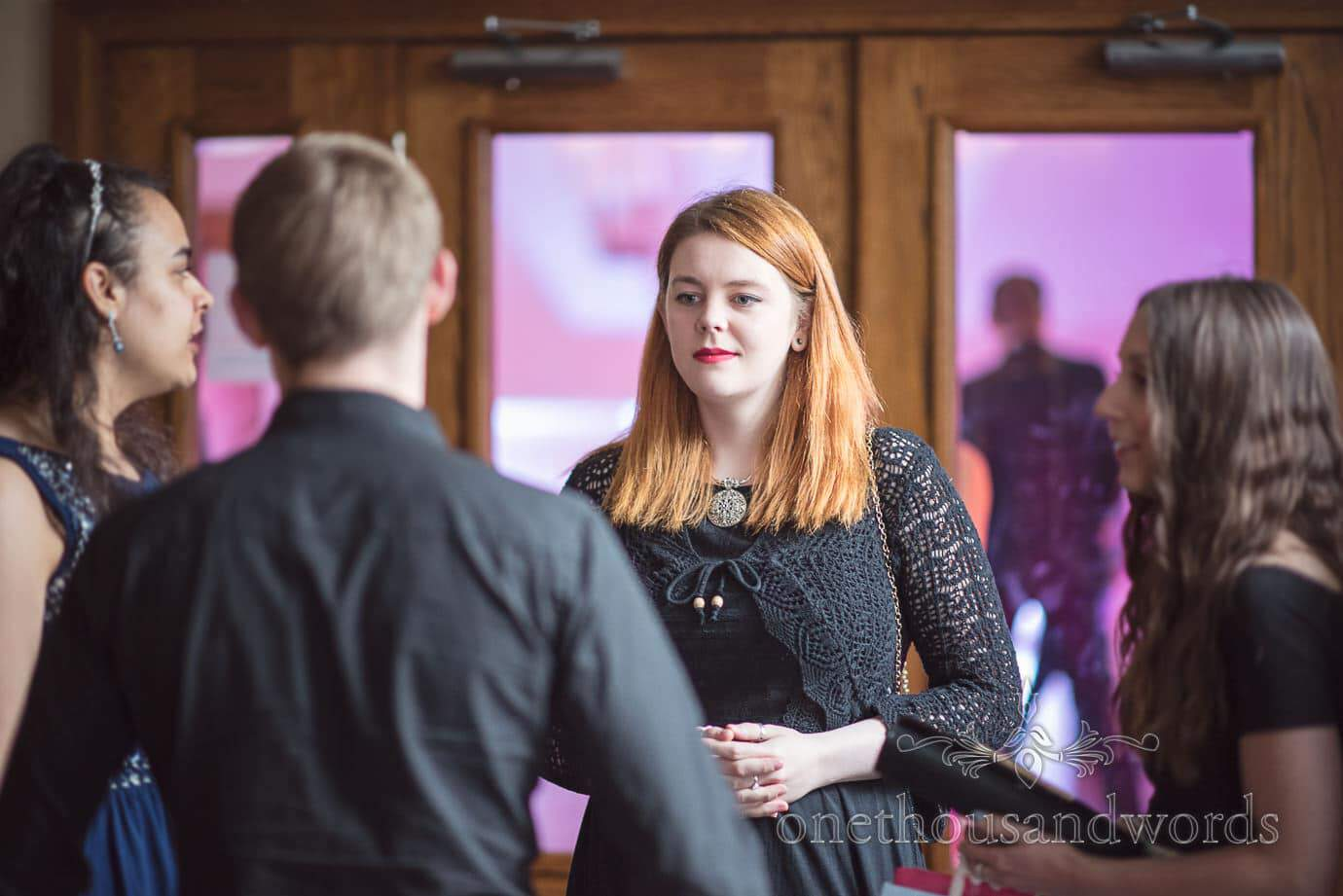Beautifully Solemn Red head wedding evening guest at Haven Hotel wedding venue