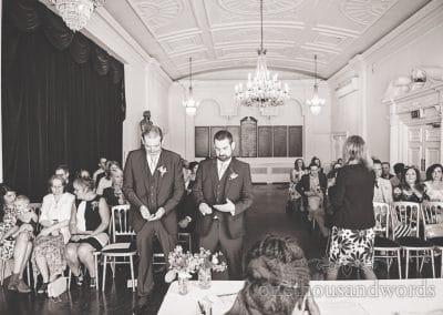 Black and white documentary wedding photo of nervous groom at Trafalgar Tavern