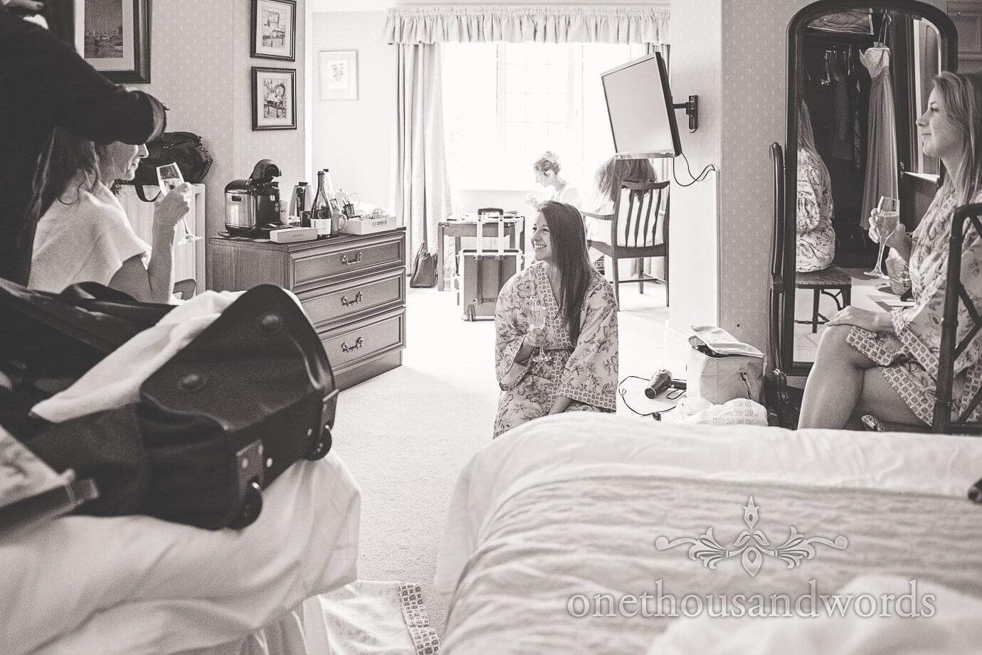 Black and white documentary wedding photograph of bridal preparation on wedding morning