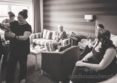 Black and white documentary wedding photograph of bridal preparations at Haven Hotel