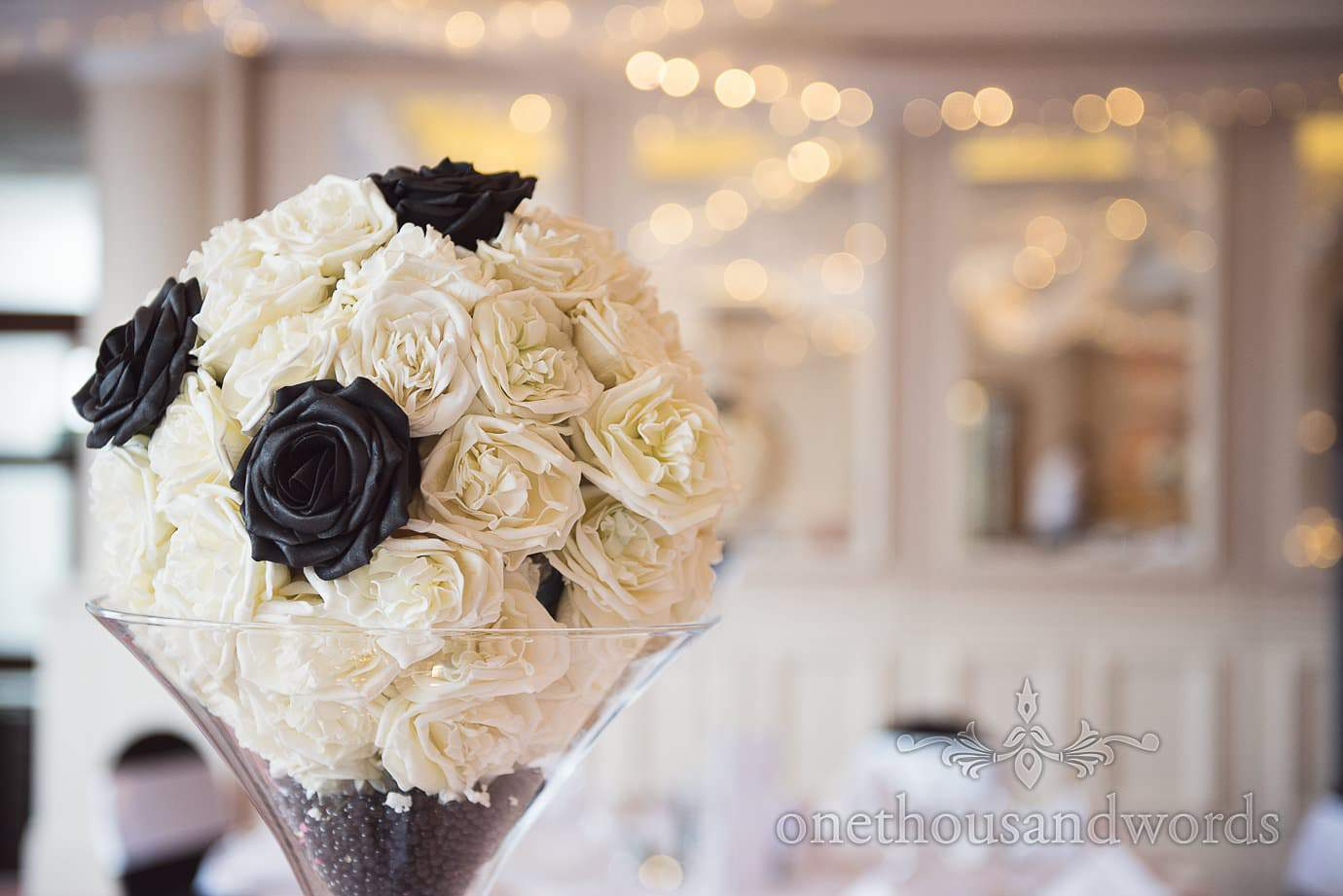 Black and white flower table spray in Martini vase at rock and roll wedding