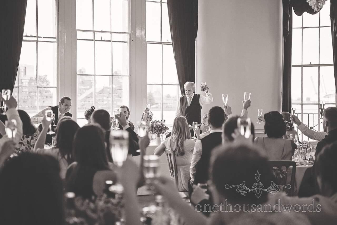 Black and white photograph of wedding speeches toasts at Trafalgar Tavern wedding