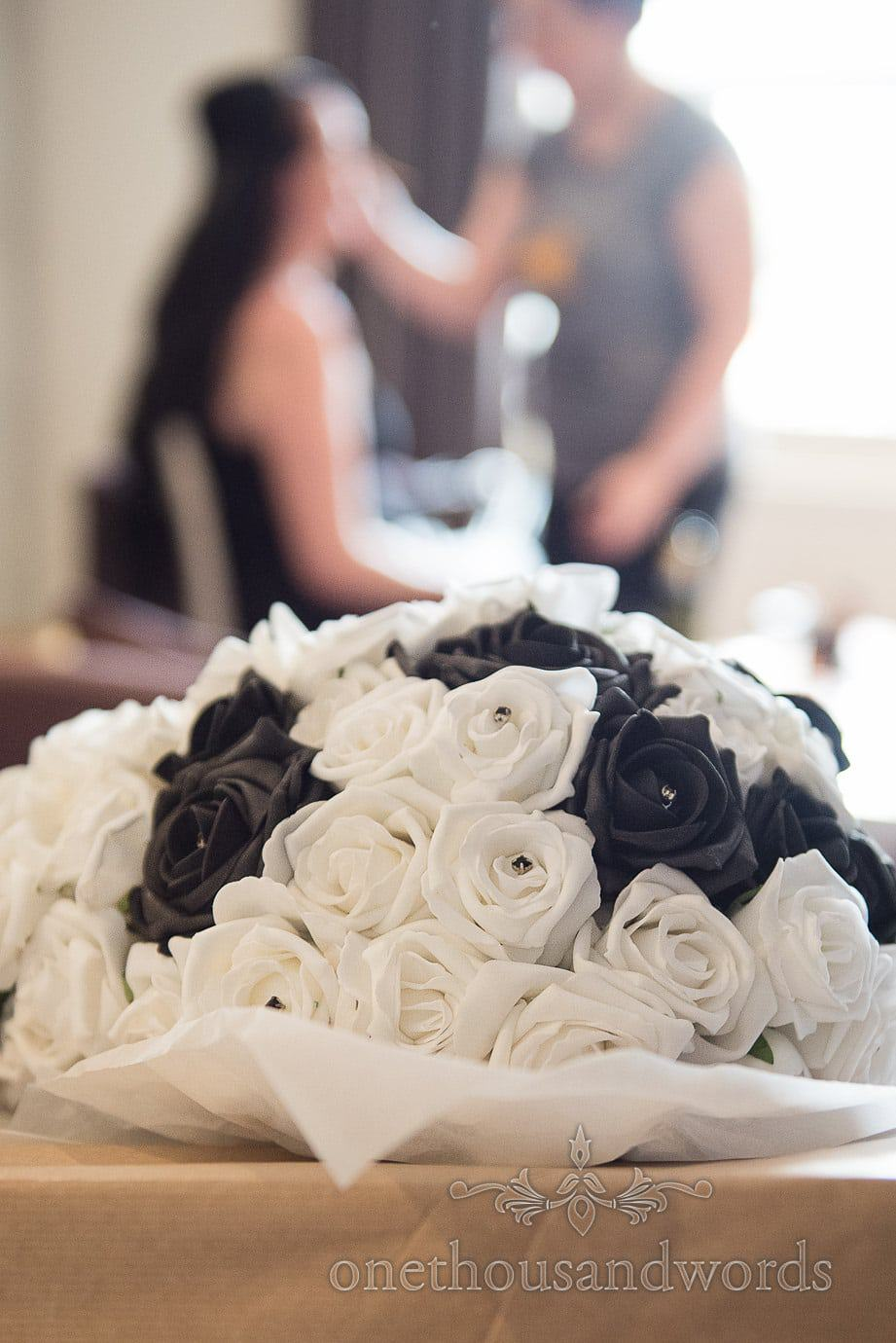 Black and white rose wedding bouquet at Rock and Roll wedding morning preparations