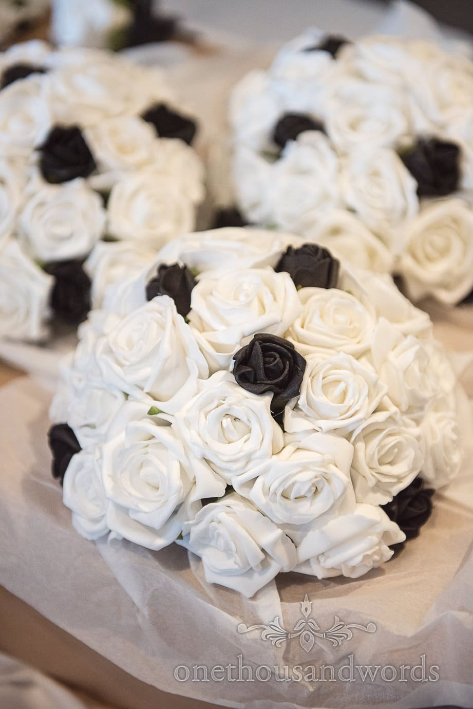 Black and white rose wedding bouquets at black and white themed Rock and Roll wedding