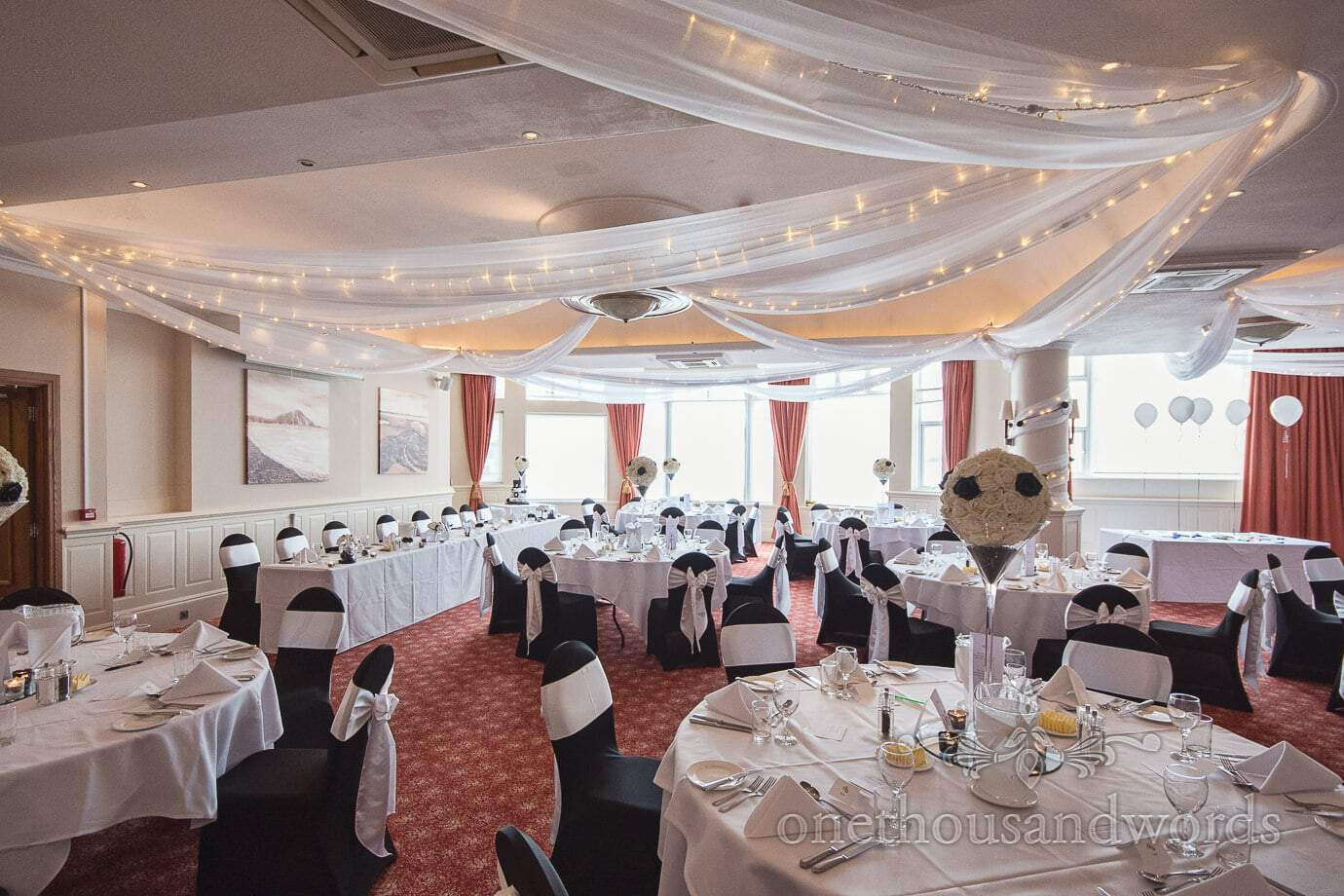 Black and white themed rock and roll wedding wedding breakfast room decorations at Haven Hotel
