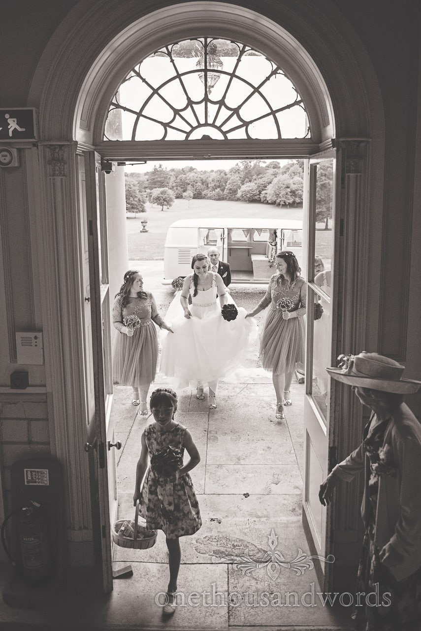 Black and White wedding photograph of bride arriving at Upton House wedding