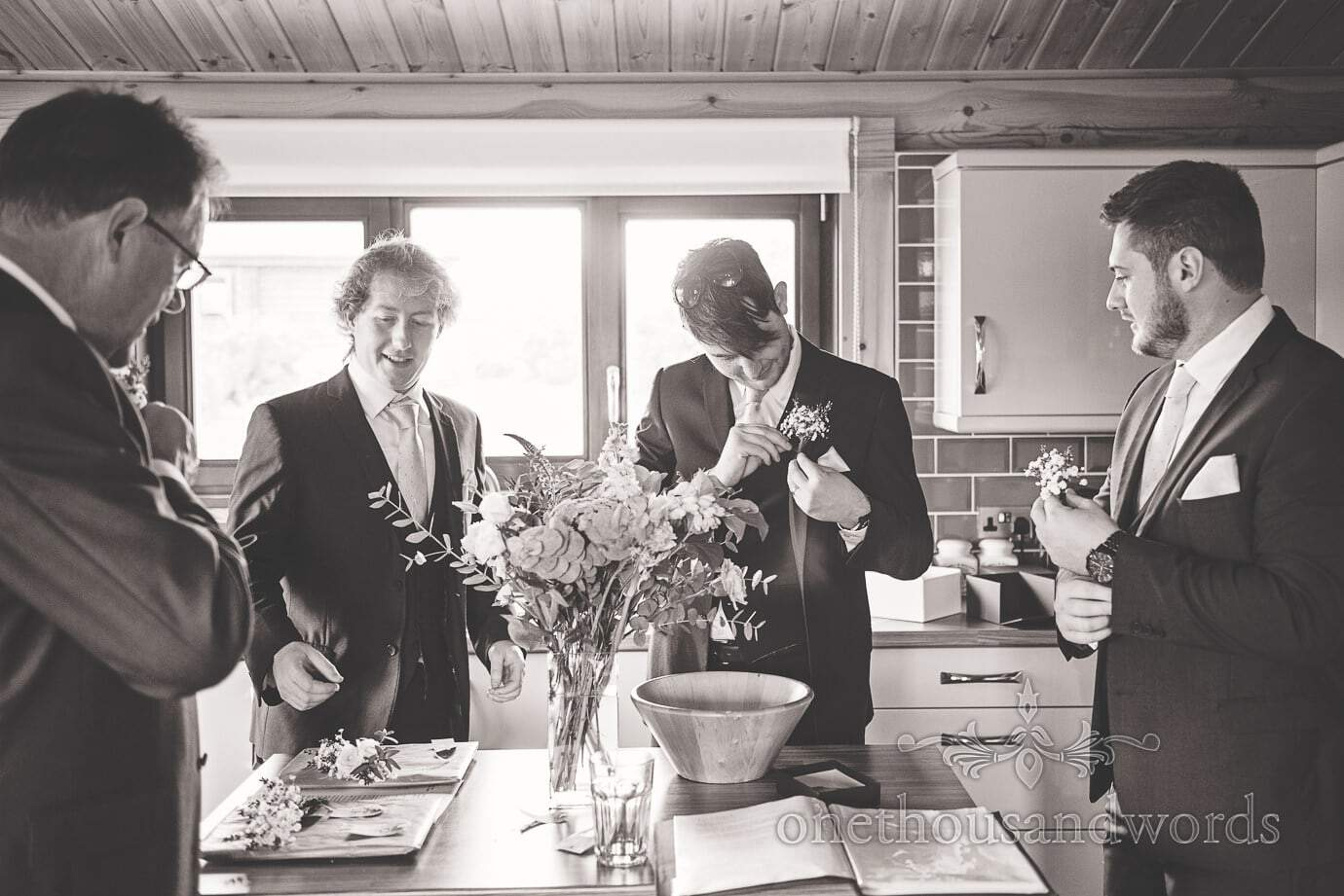 Black and white wedding photograph of grooms morning wedding preparation