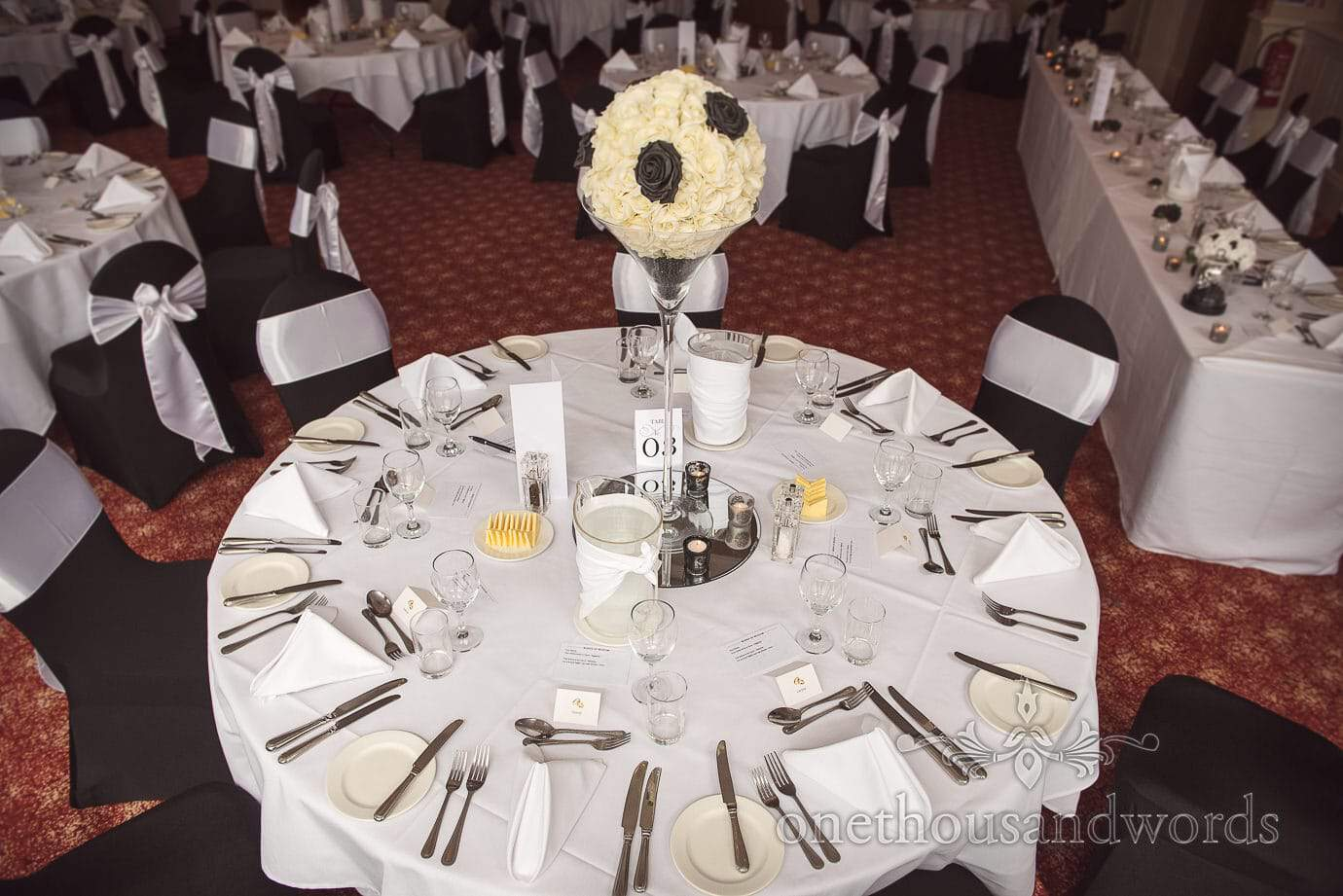 Black and white wedding table decorations and flowers at rock and roll wedding