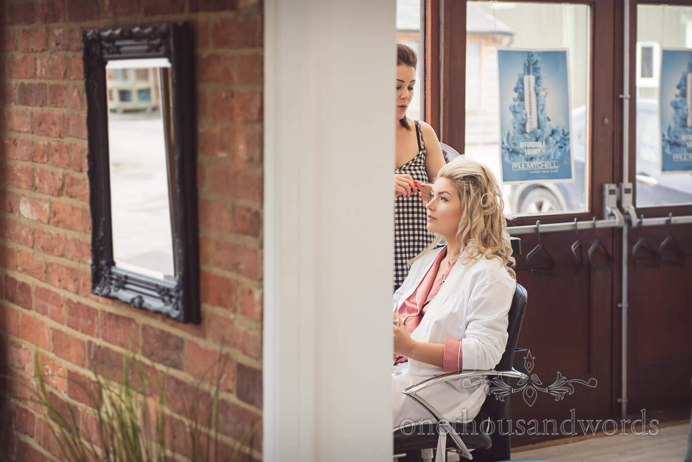 Blonde bride has wedding hair styled at bridal beauty salon in Leicestershire