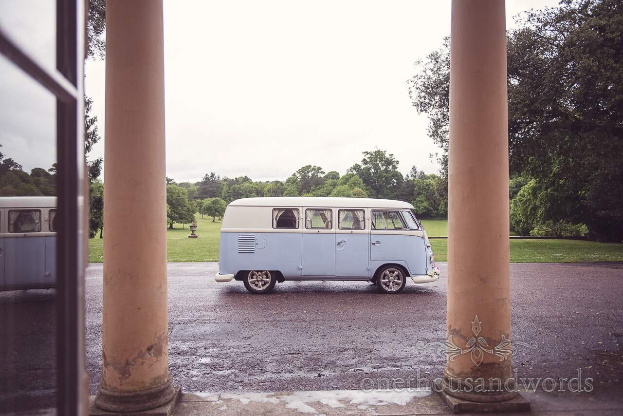 Blue and white classic VW wedding van outside stone columns of Upton House wedding