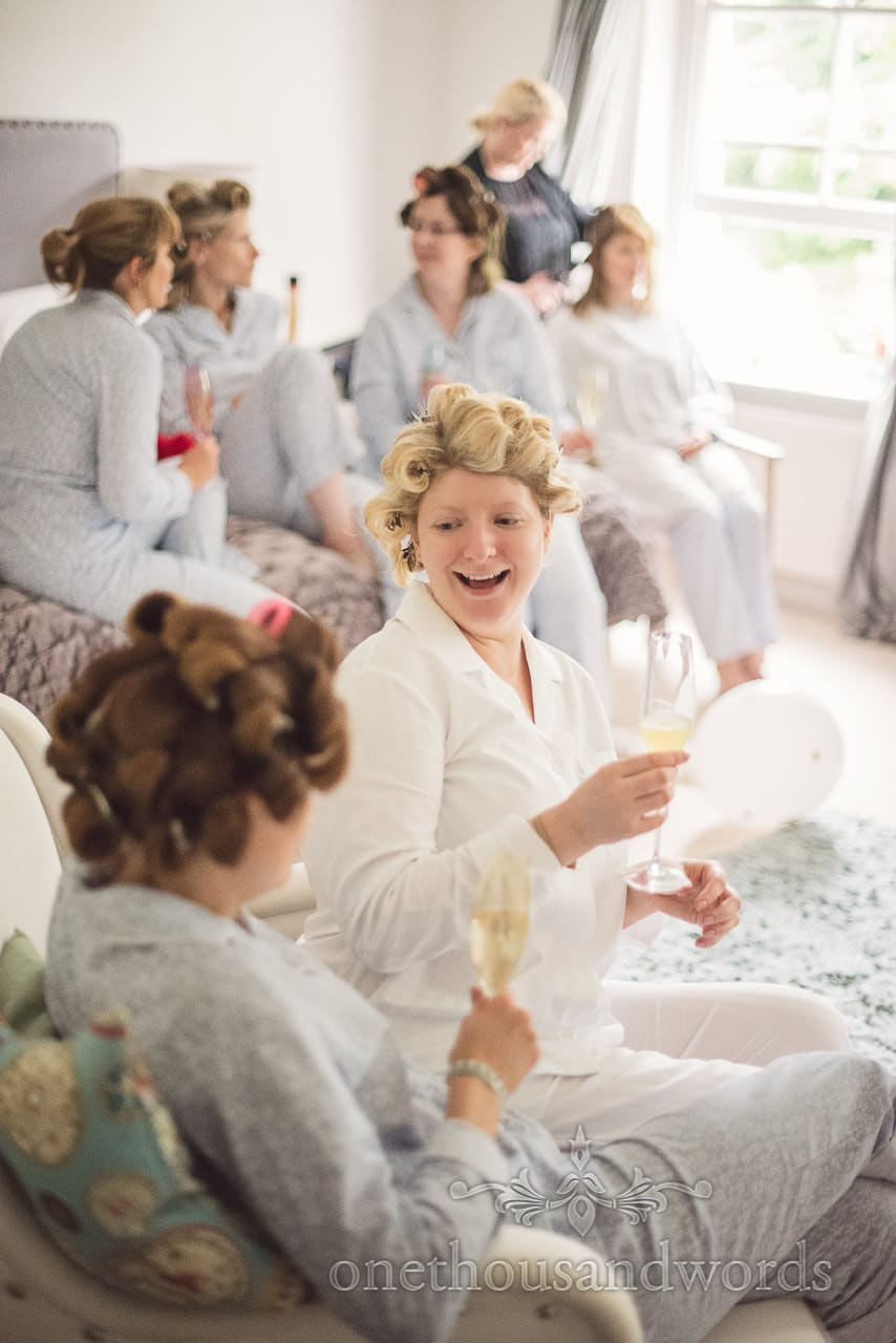 Bridal party enjoying bubbles on wedding morning