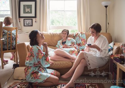 Bride and bridesmaids on couch on morning of Greenwich wedding photographs