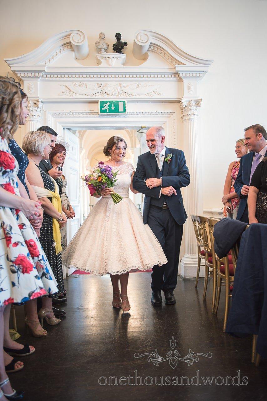 Bride and father enter wedding ceremony room at Trafalgar Tavern wedding ceremony in Greenwich