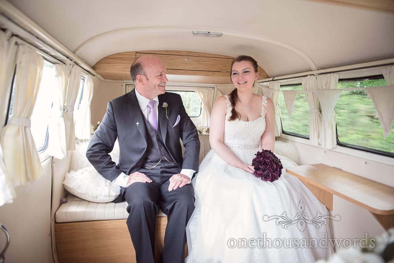 Bride and father of the bride ride in Classic VW camper van to wedding