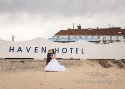 Bride and groom at beach wedding venue Haven Hotel in Poole, Dorset
