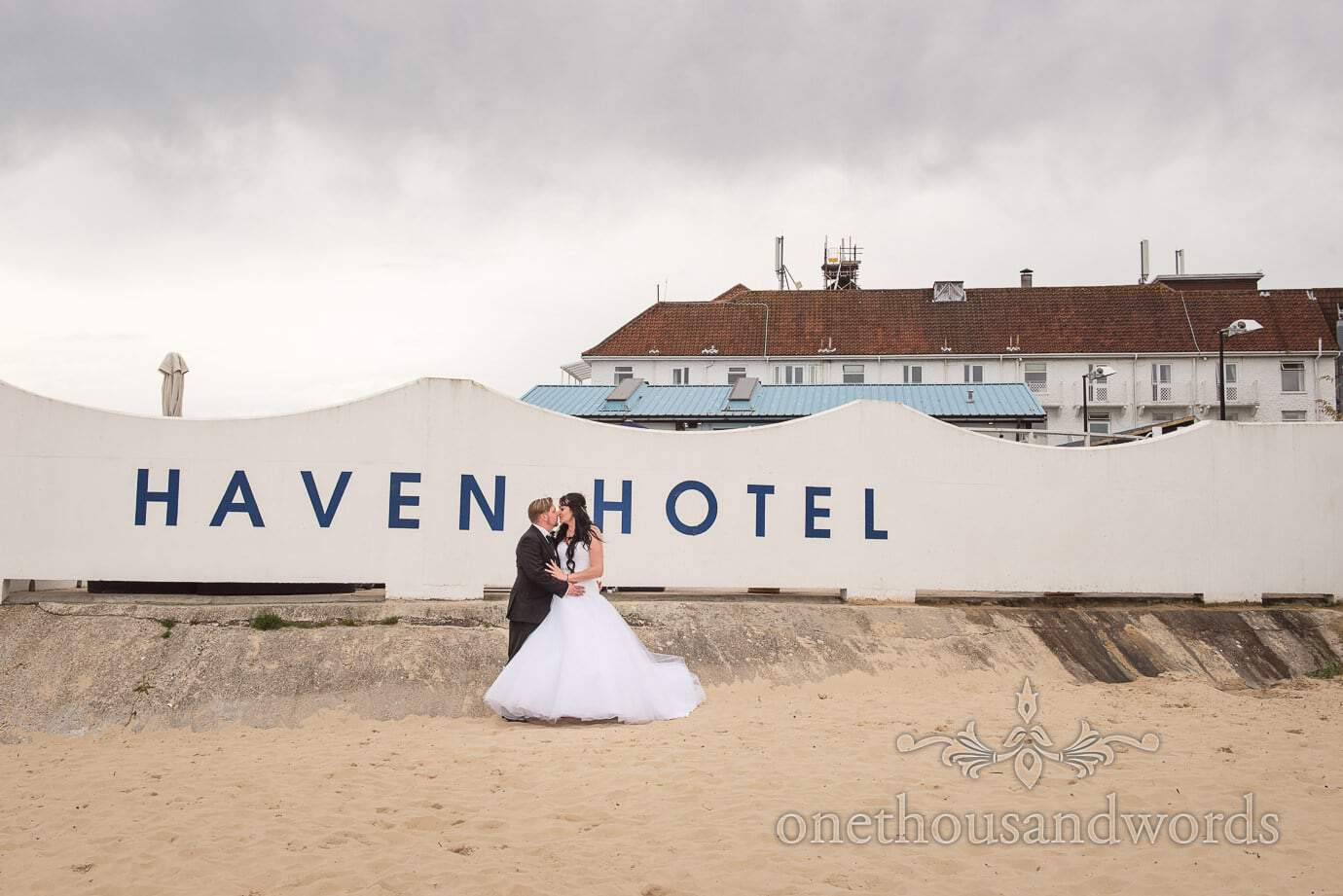 Bride and groom at beach wedding venue Haven Hotel in Poole, Dorset