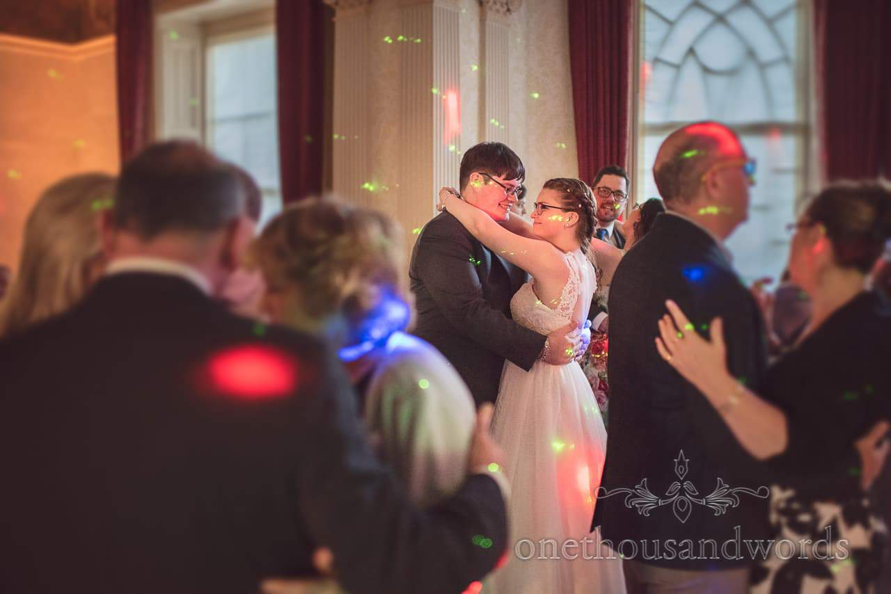 Bride and Groom dance with wedding guests at Upton House wedding
