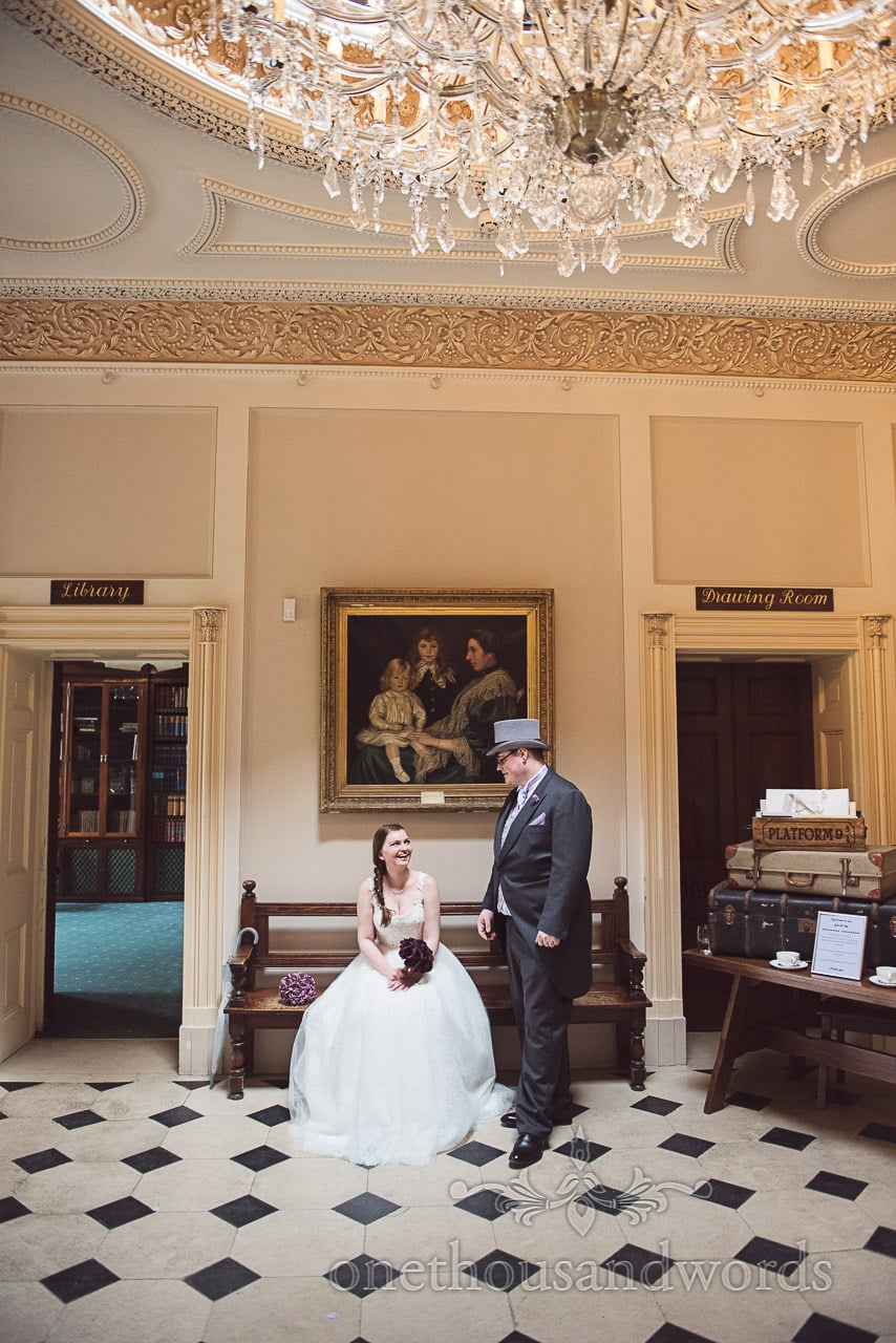 Bride and groom in entrance hallway at Upton House Wedding Venue in Poole
