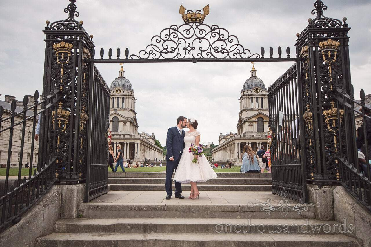 Bride and groom kiss in the gates at Greenwich University from Greenwich wedding photographs