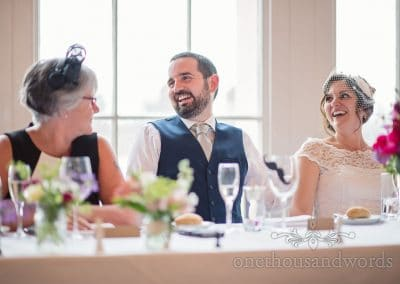 Bride and groom laugh during wedding speeches at Trafalgar Tavern Wedding venue