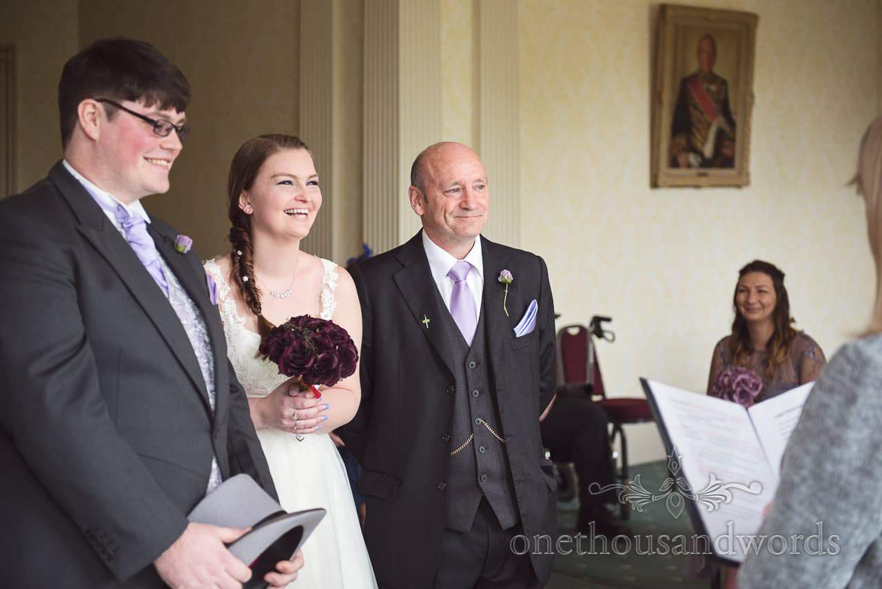 Bride and groom laughing at Upton House wedding ceremony