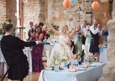 Bride and groom make dramatic entrance to wedding breakfast at Lulworth Castle wedding