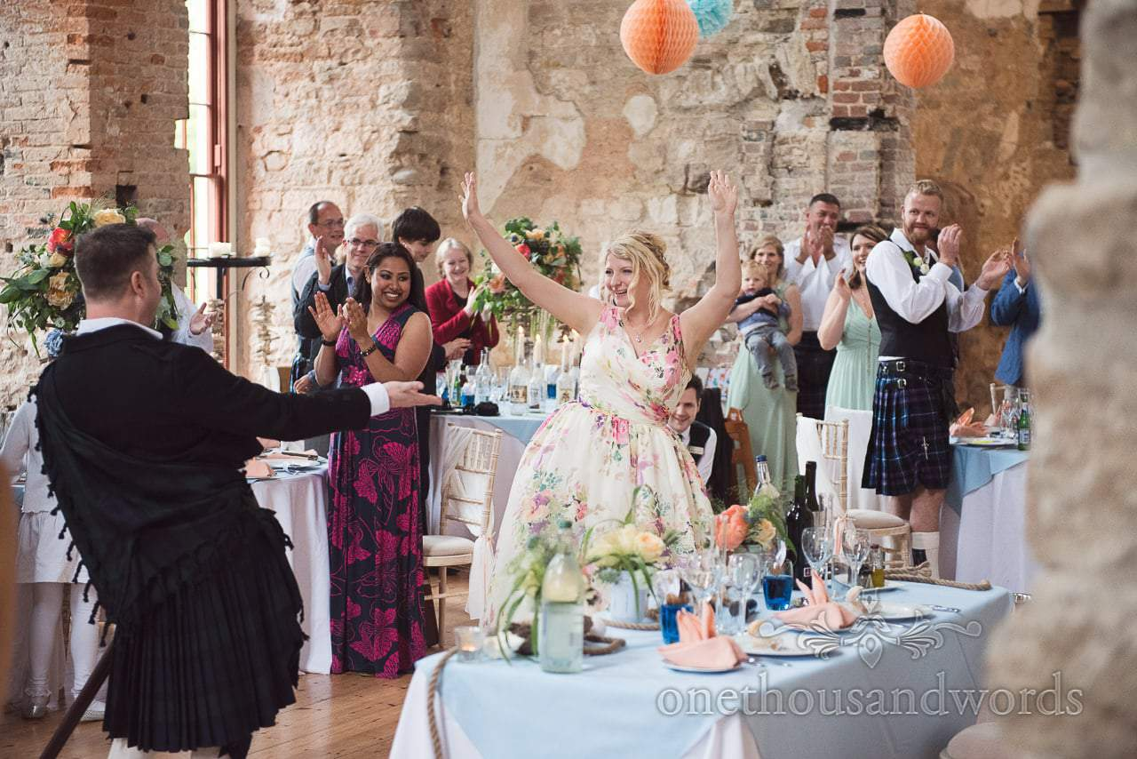 Bride and groom make dramatic entrance to wedding breakfast at Lulworth Castle wedding