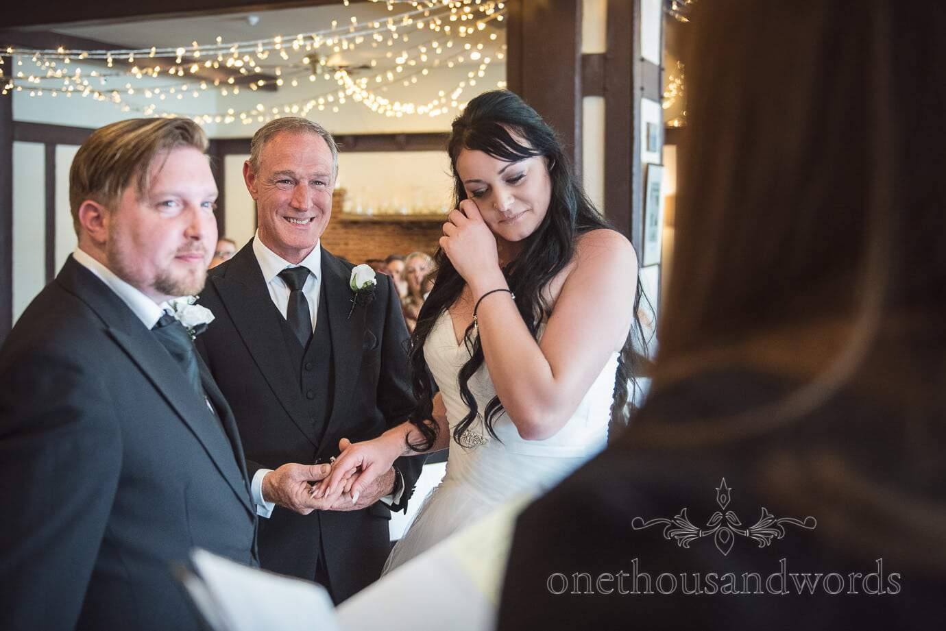Bride cries as father hands her over at rock and roll wedding with black and white theme