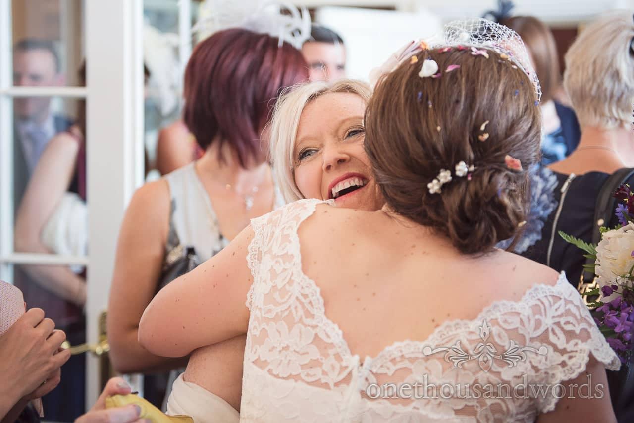 Bride hugs wedding guests at Trafalgar Tavern Wedding venue drinks reception