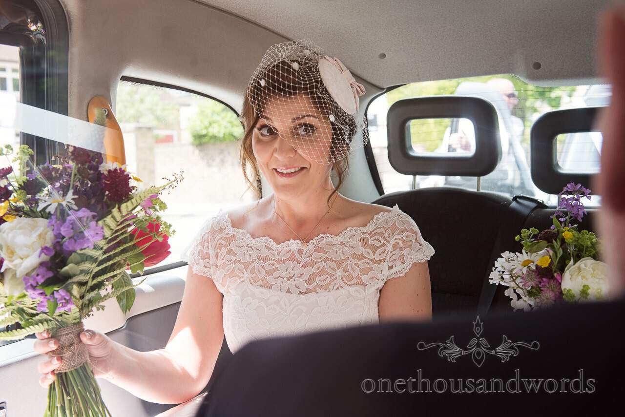 Bride in back of London cab from Greenwich wedding photographs