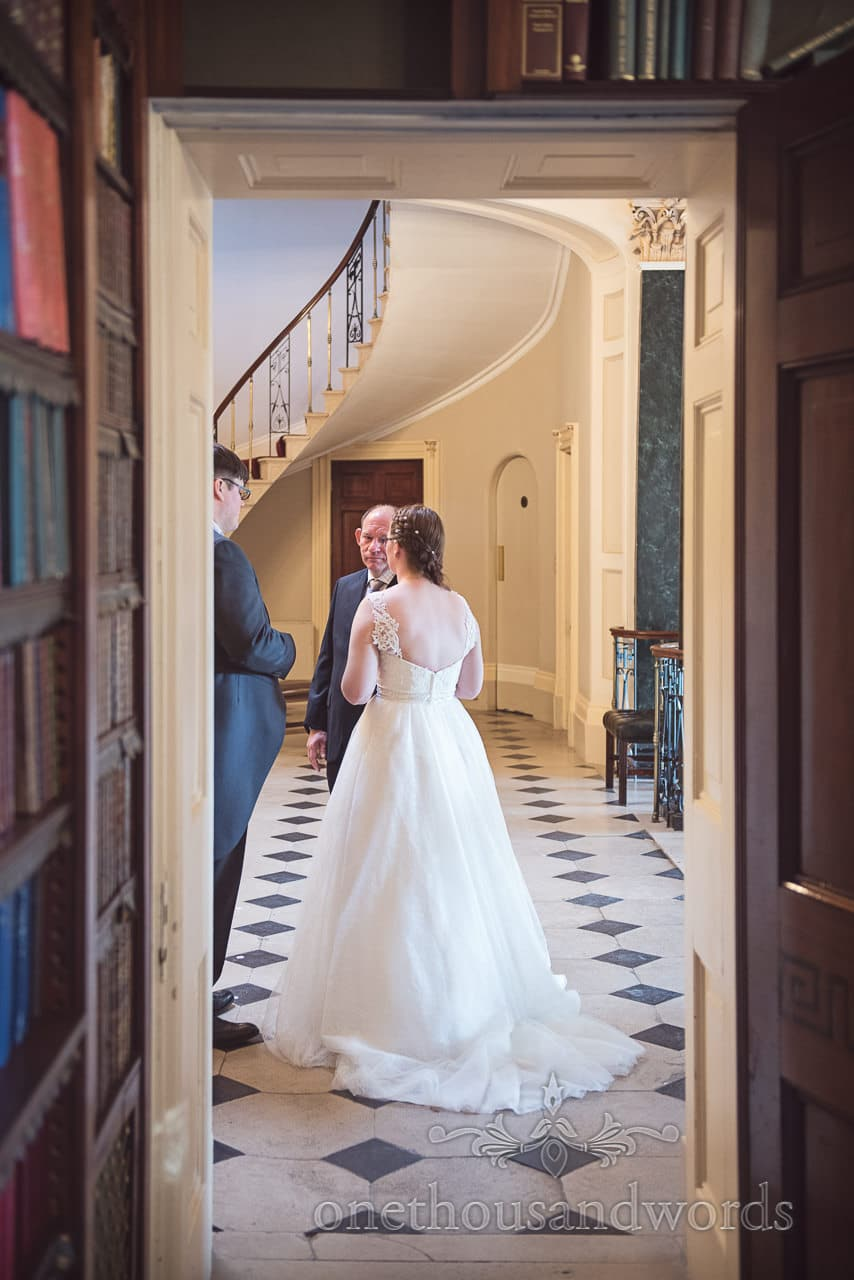Bride in white wedding dress on chequer floor at Upton House wedding