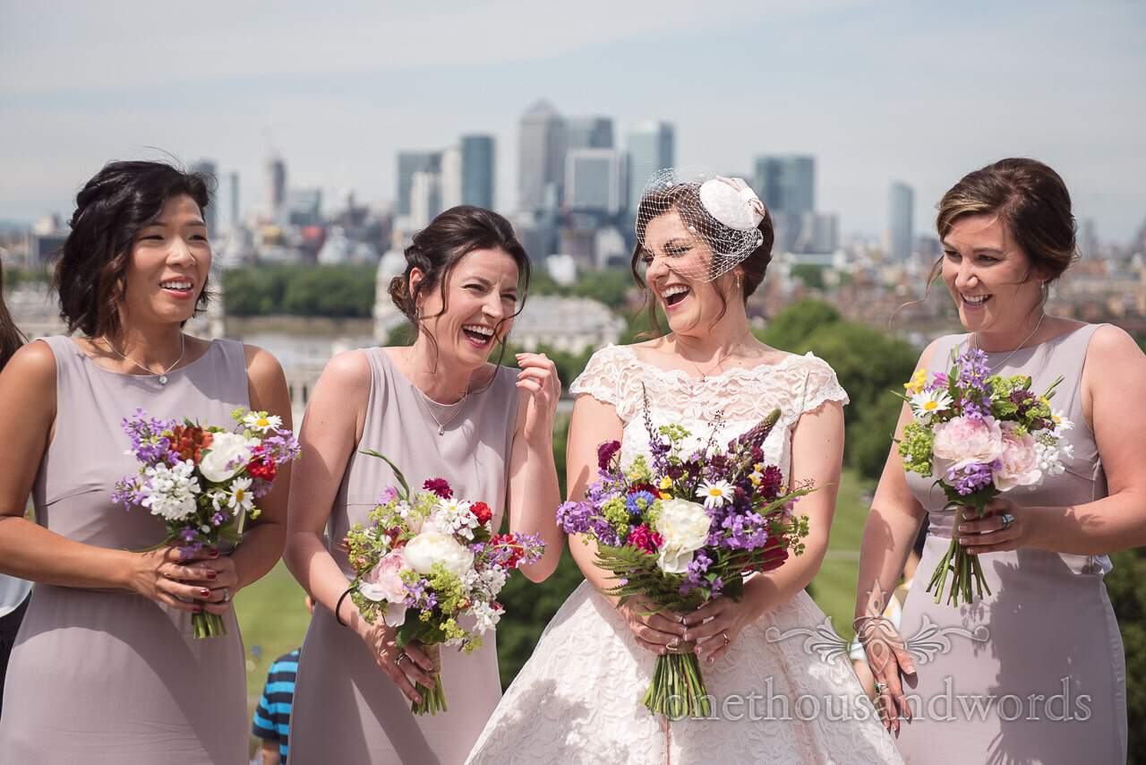 Bride shares a joke with her bridesmaids on morning Greenwich wedding photographs