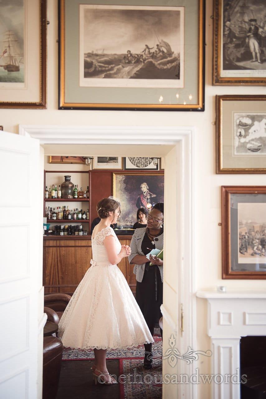Bride talks to registrar at Greenwich wedding photographs
