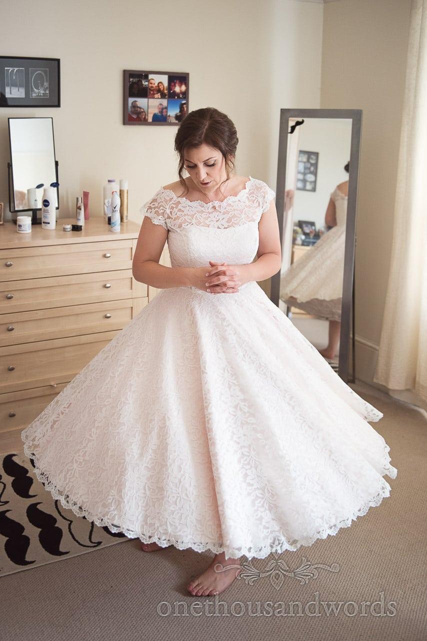 Bride twirls in her retro lace wedding dress