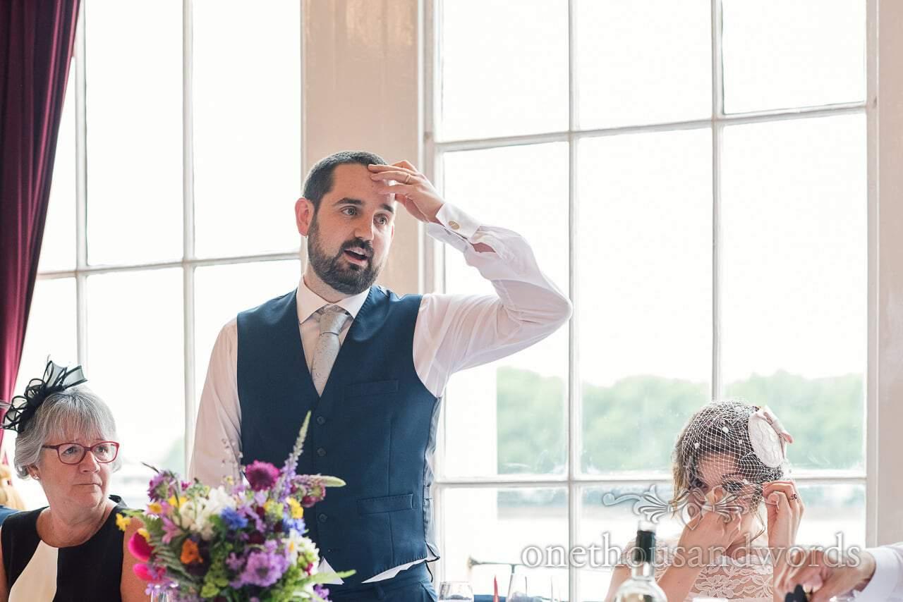 Bride wipes away tears during grooms wedding speech at Trafalgar Tavern wedding