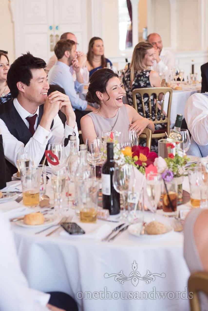 Bridesmaid and wedding guests laughter reaction to wedding speeches at Trafalgar Tavern