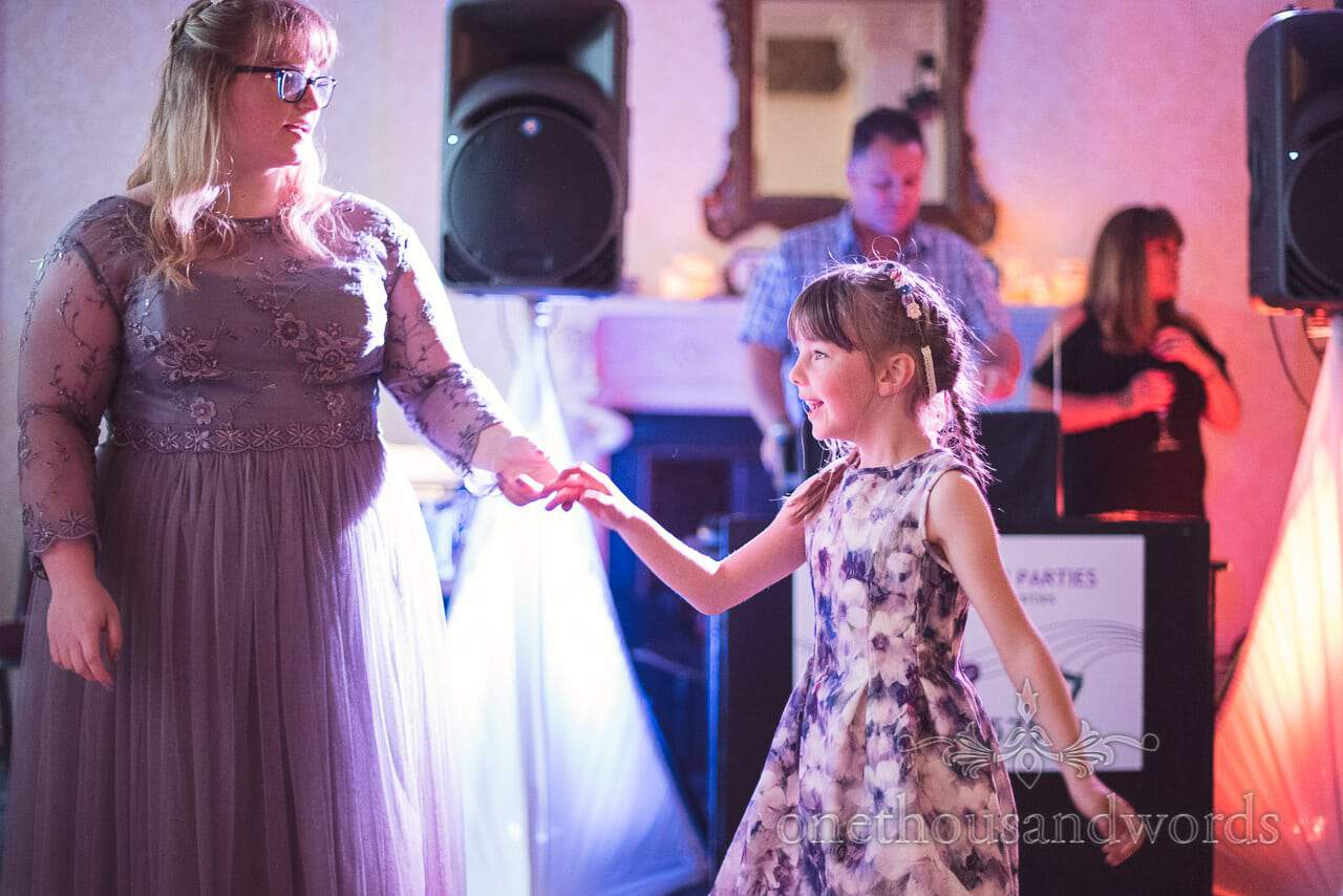 Bridesmaid dances with flower girl at Upton Country House Wedding