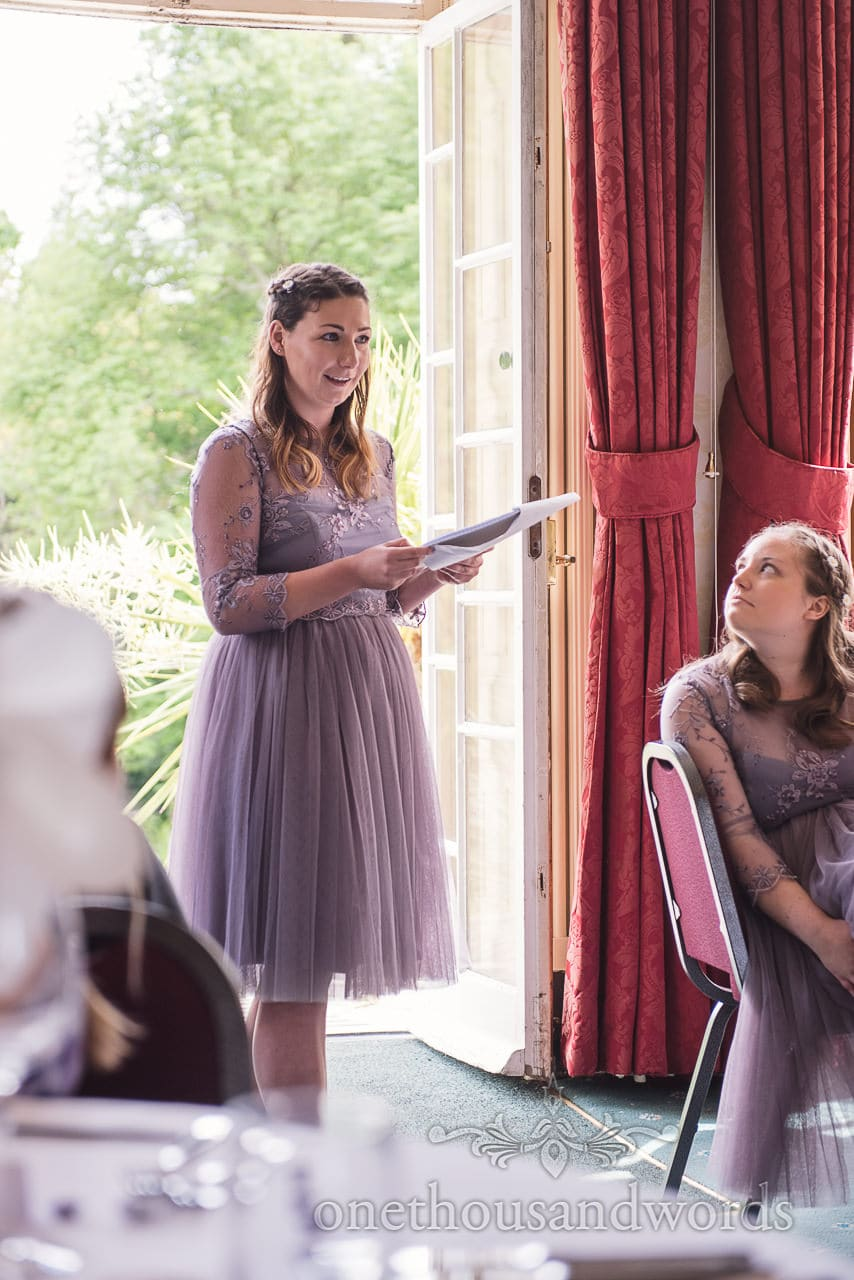 Bridesmaid in dusty violet gives rhyming wedding speech at Upton House wedding