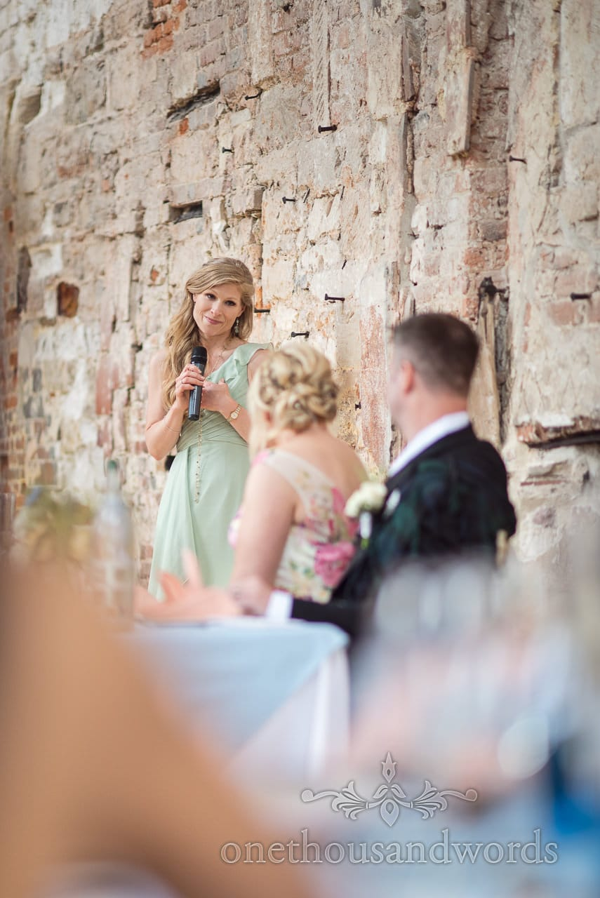 Bridesmaid makes emotional wedding speech at Lulworth Castle wedding in Dorset