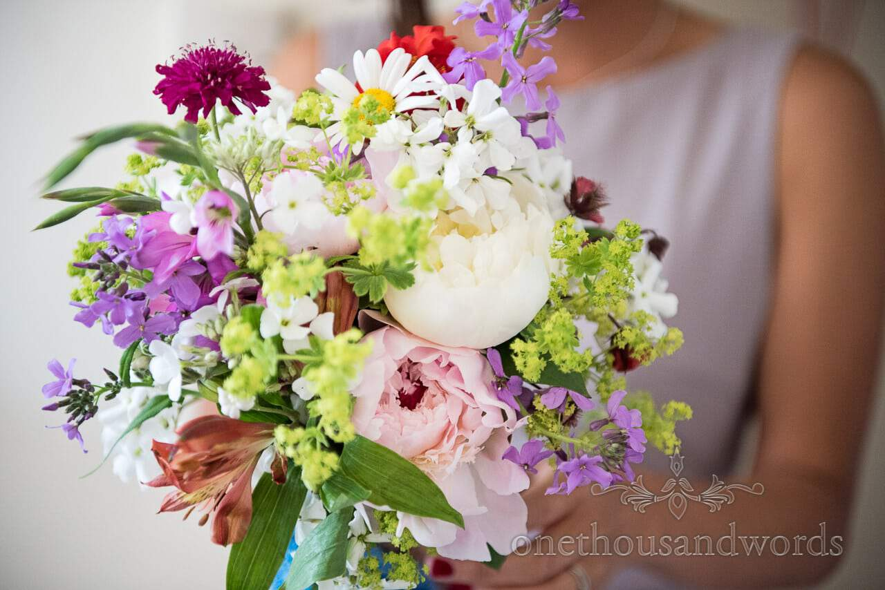 Bridesmaid with colorful wedding bouquet from Greenwich wedding photographs