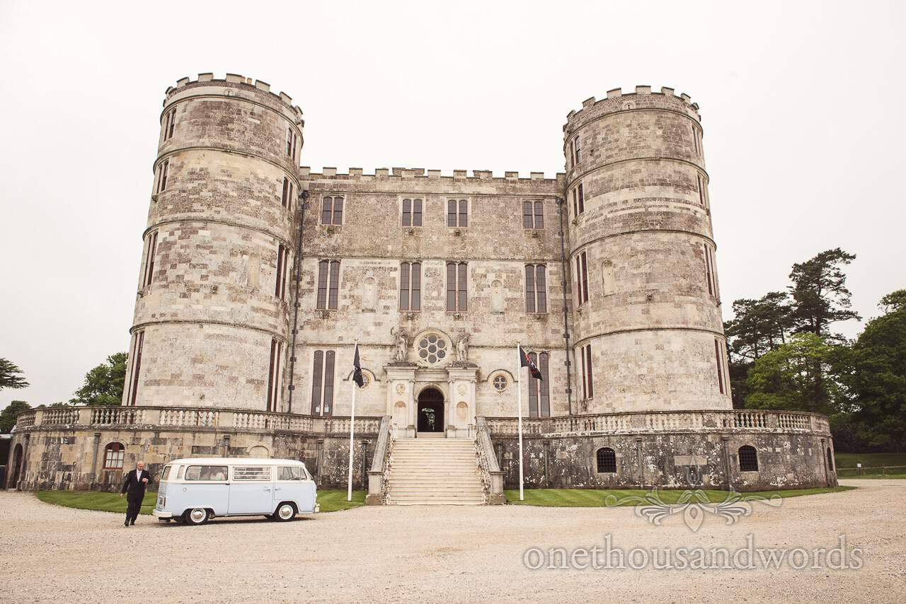 Bridesmaids arrive in Volkswagen bus at Lulworth castle wedding