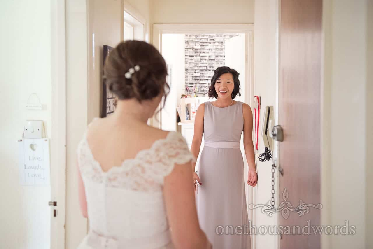Bridesmaids reaction to seeing bride in dress from Greenwich wedding photographs