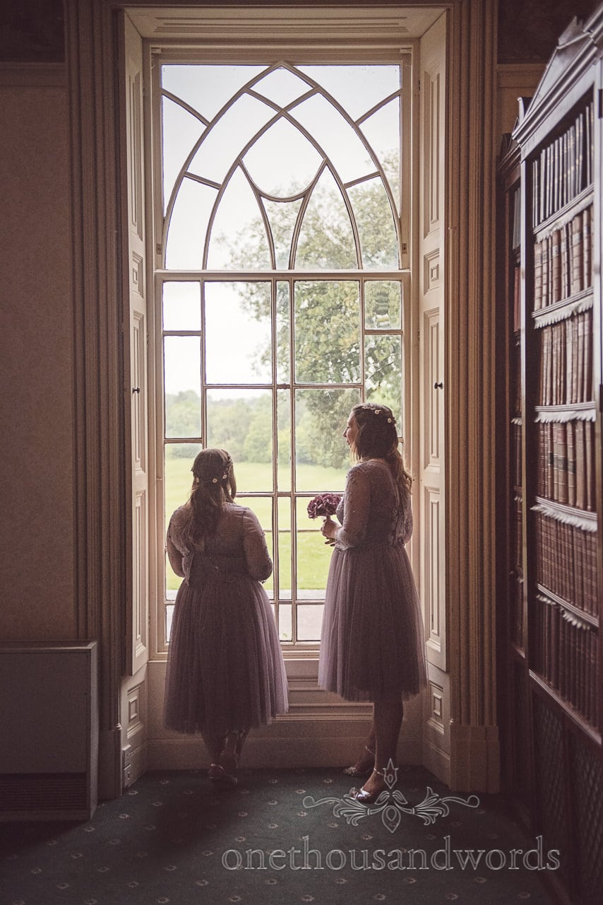 Bridesmaids wait by window before Upton House wedding ceremony