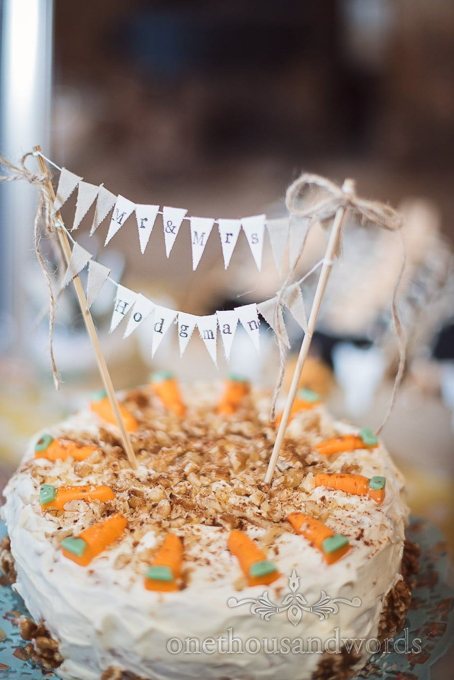 Carrot cake with personalised mini bunting decoration at rustic barn wedding