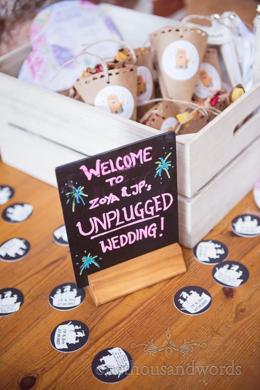 Chalkboard and confetti cones at Lulworth castle wedding