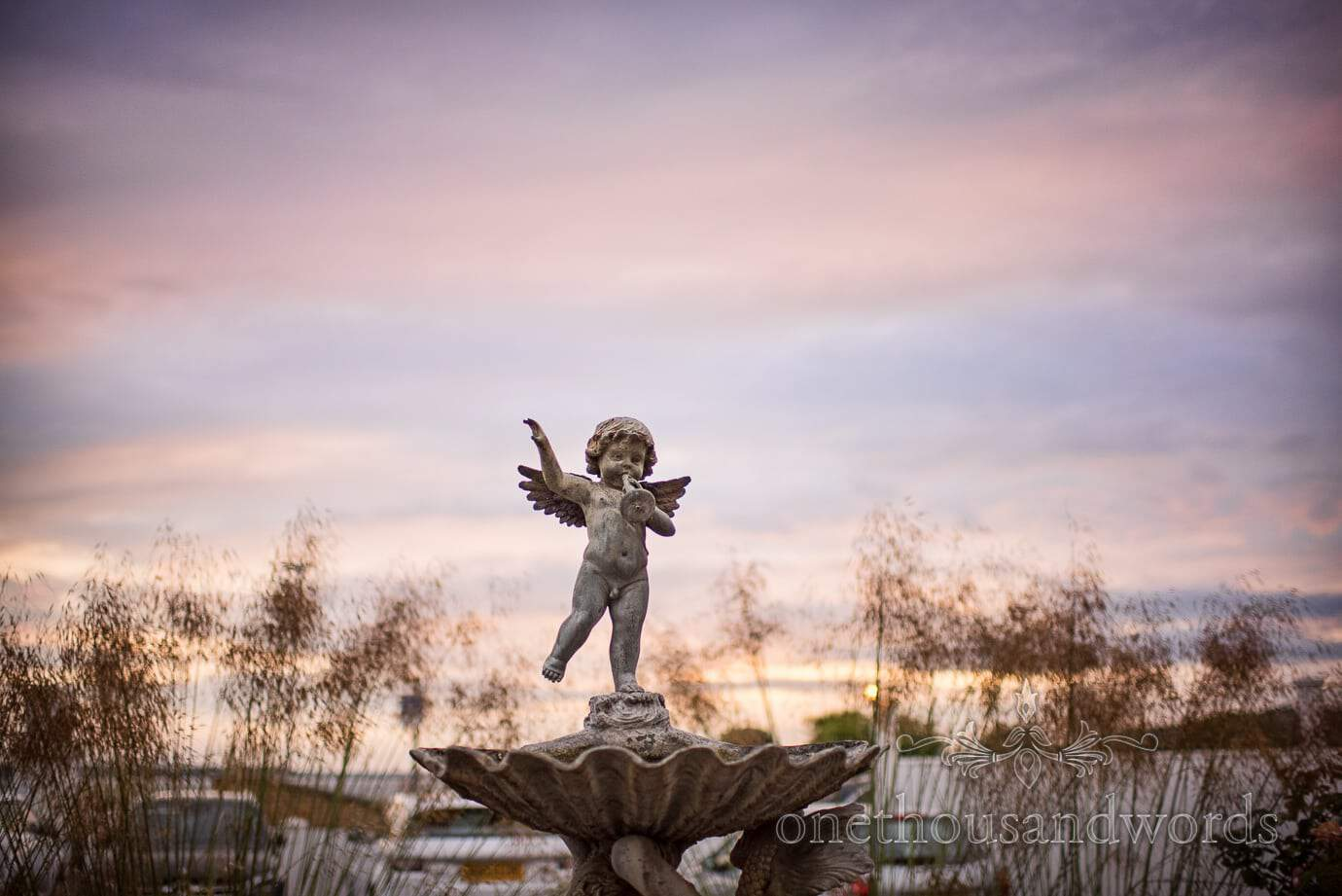 Cherub fountain with sunset at Haven Hotel Wedding venue in Poole